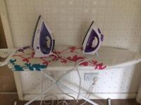 2 irons and ironing board