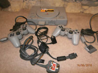 PS1 console with two controllers and memory card