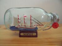 Sopot ship in a bottle on wooden plinth. £2.
