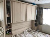 Fitted over bed wardrobe