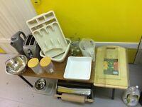 Kitchen items: Bread bin, pyrex dishes, basin set, fruit bowel, chopping boards