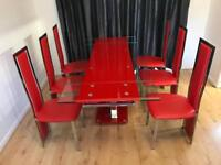 Enke red extendable glass dining table and chairs