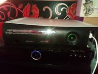 Xbox 360 with four controllers and 17 games