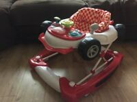 RED CAR style BABY Walker. Adjustable height with activity toys and sounds like new.
