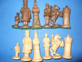 A SUPERB RESIN MEDIEVAL TYPE CHESS SET AND BOARD