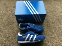 Boys Adidas trainers. With original box. Blue. Childrens UK Size 11. Really good condition.