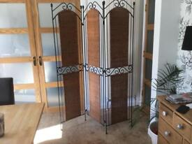 Wrought iron and wicker divide screen