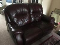 Two seater oxblood / brown leather reclining sofa