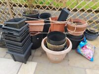 An assortment of plastic plant pot. Large, medium and small