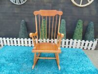 SOLID PINE ROCKING CHAIR VERY SOLID CHAIR AND IT'S IN VERY GOOD CONDITION 57/45/104 cm £45