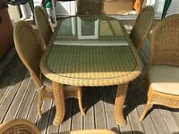 Glass and wicker table in good condition includes 2 carver chairs