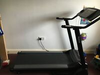Reebok running machine. Works very well. Need gone.