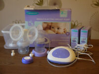 Lansinoh single electric breast pump (with box and instructions),