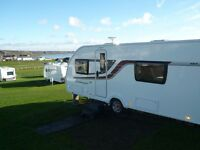 Touring Caravan Swift Challenger 565SE May 2014 one owner Immaculate Condition sited with Awning