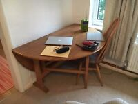 Ercol oval dropleaf table with four Windsor chairs
