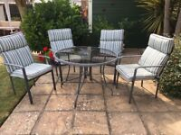 Glass top round garden table and 4 chairs