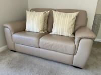 2 x 2 seater leather sofas and storage footstool