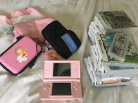 Nintendo DS for sale with games and accessories for sale (mario included)