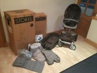 **STOKKE XPLORY** cream/brown colour with all original packaging instructions and all accessories