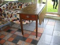 Old pine and beech kitchen table, one drop leaf and one drawer.