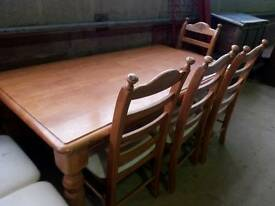 Stunning solid pine table with six chairs