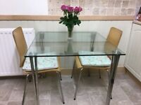 Glass topped table and chairs