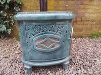 French enamel wood burning stove.