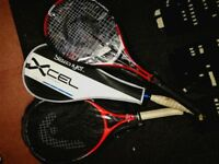 Two tennis rackets and one squash racket