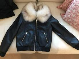 Girls River Island leather bomber jacket.