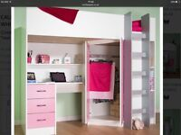 High bed with table and cupboard