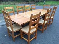 Solid oak extending dining table and chair set . Possible Delivery