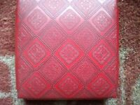 A RED LEATHER JEWEL BOX WITH MIRROR 6X6X2 INCHES