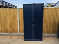Tall metal blue Roneo tambour unit
