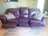 leather burgandy couch reclines on both sides