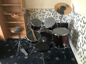 Fantastic 9 piece drum kit complete with 3 cymbals and stands and drum mutes