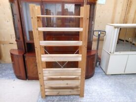 7 shelf pine wooden shoe rack that fits in side a cupboard. can deliver