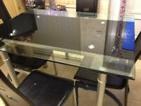 BRAND NEW KITCHEN GLASS TABLE ADJUSTABLE WITH FOUR BLACK CHAIRS £250 - WHATS APP ONLY