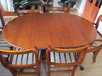 Extending oval dining table 4 chairs 2 carvers in cherry. all in good condition.