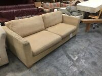 Beige large two seat sofa