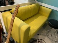 Ikea Askbey 2 seater yellow sofa bed (great for a young person's room)