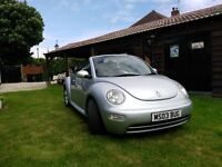 V.W. Beetle silver convertible 2 litre. Have fun in the sun!