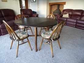 ERCOL DINING TABLE and 4 CHAIRS. FOLDS DOWN BOTH SIDES. Will sell separately.