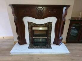 Mahogany fireplace and electric fire