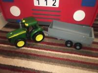 Large john Deere tractor and trailer