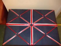 Used Union Jack notice board with grey background with ribbon detail