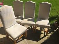Four fabric covered dining chairs
