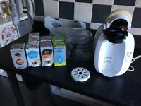 White tassimo machine with pods