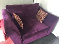Beautiful snuggler armchair in dark plum. Less than 2 years old and in excellent condition