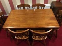 Antique solid oak table and six chairs