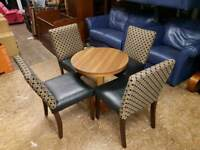 Black leather and fabric chairs with oak table